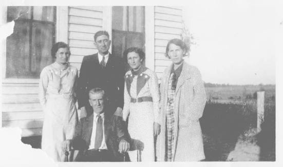 Pa Crowell and his four children.  My great, great grandmother, Ora, is on the left.
