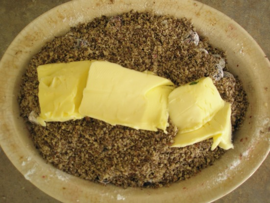 Coat the top of the dish with your nut meal and a pinch of sea salt.  Layer the top with pastured butter or ghee.