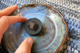 kyphi incense on charcoal disc